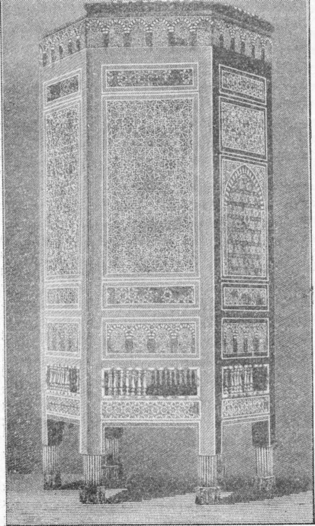 Fig. 293 — Mesa de madeira incrustada, do Cairo, segundo fotografia.