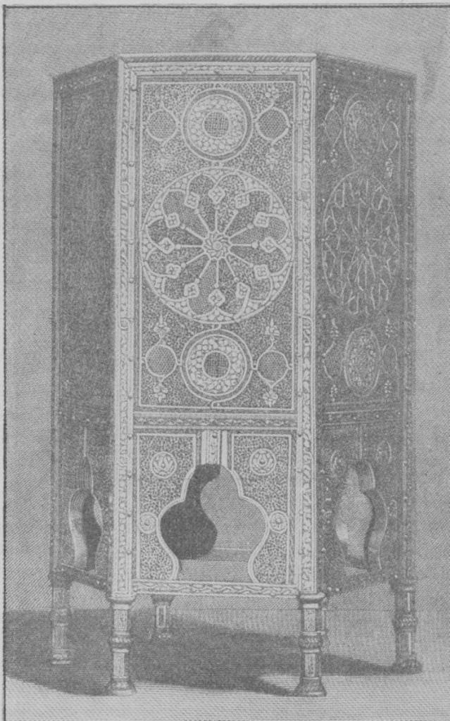 Fig. 288 — Mesa de centro árabe, em bronze com incrustações de pi fotografia do autor.